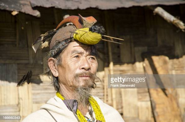 Old Nishi men still wear the typical headdress including the beak of the Hornbill bird