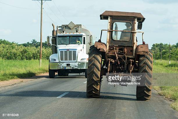 Old obsolete Russian agricultural tractor circulating in the Central Road The low requirements for getting a tractor driver license make this...