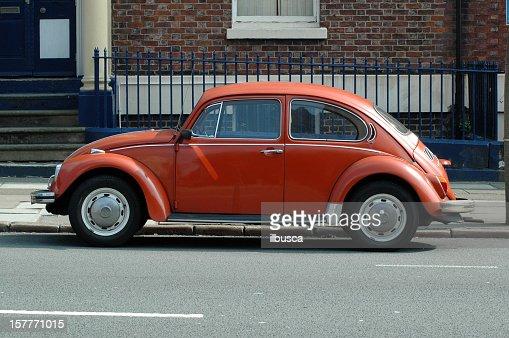 Old orange Volkswagen Beetle in the street
