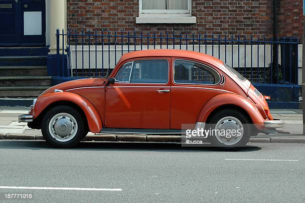 Old orange Volkswagen Beetle in the street