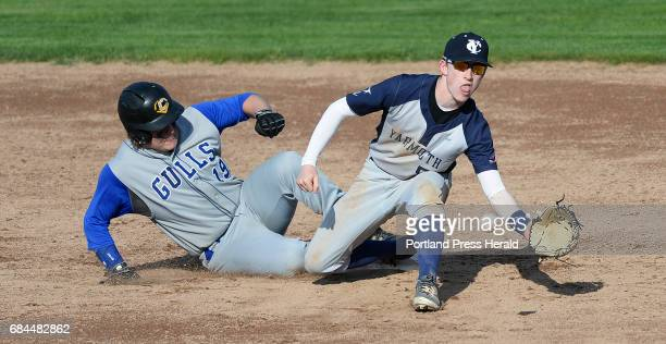 Old Orchard Beach's Matt Hurley slides into second base as Yarmouth's Chris Romano waits for the ball Wednesday May 17 2017