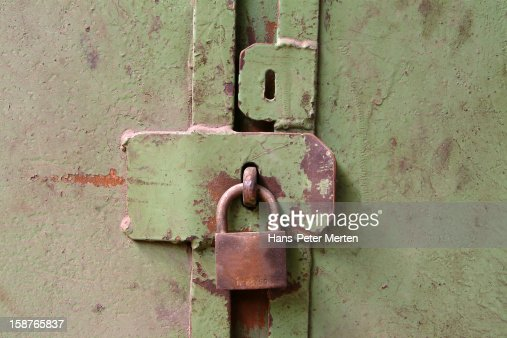 old padlock at locker : Stock Photo