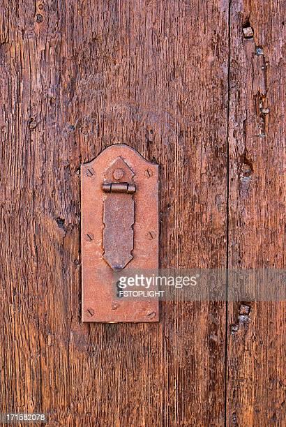 Old padlock on ancient door