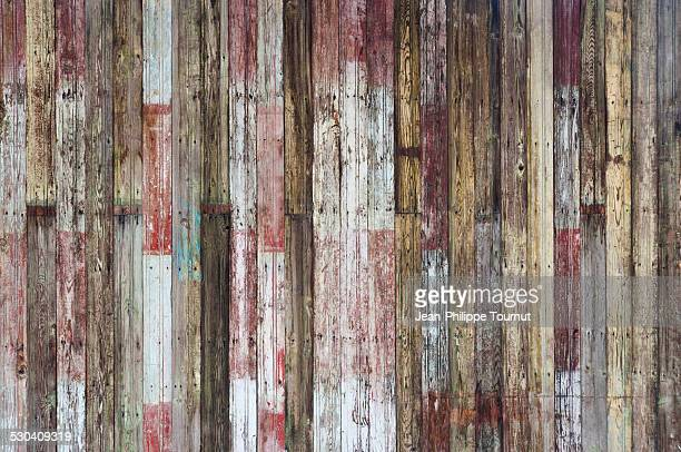 Old paint on planks of a wooden wall
