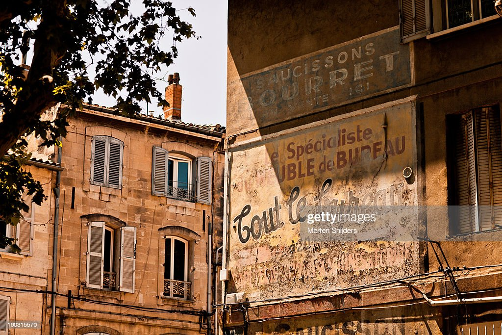 Old painted advertising signs on wall