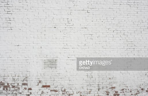 Old painted white Brick wall background pattern design