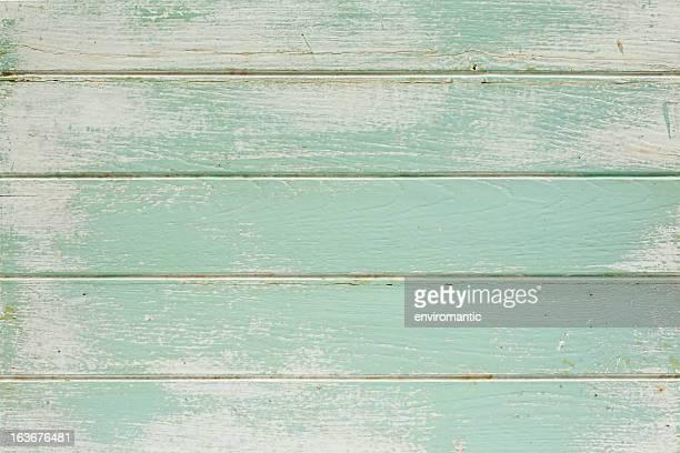 Mesa de madeira velha pintada de fundo.