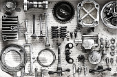 Old parts of motorcycles background with hard light black and white tone. repair and maintenance old parts of engine
