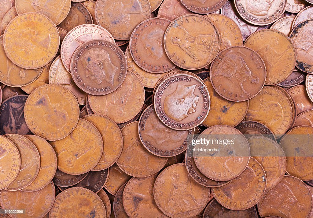 Old penny coins spread out for background : Stock Photo