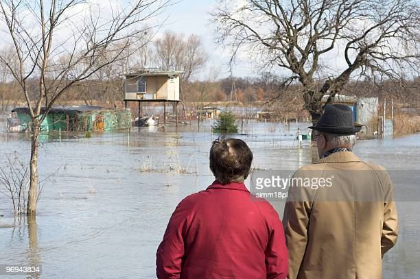 old people observing flood