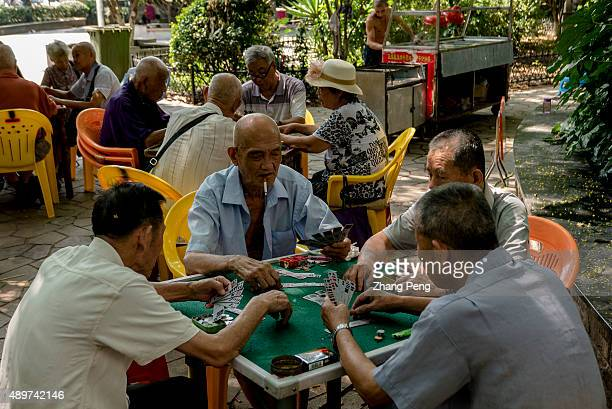 Old people play Bridge in a city park By the end of 2014 China's population aged over 60 reached 212 million making up 153% of total population and...