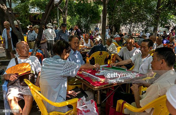 Old people play Majhong in a city park By the end of 2014 China's population aged over 60 reached 212 million making up 153% of total population and...