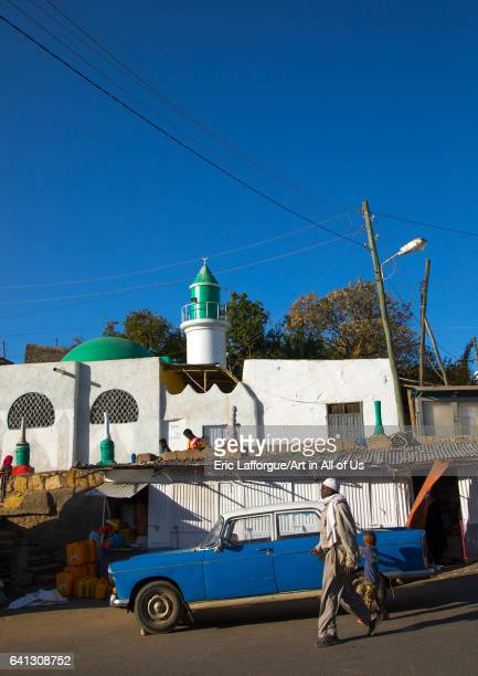 Old Peugeot 404 taxi in front of a mosque on January 11 2017 in Harar Ethiopia