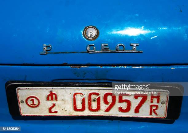 Old Peugeot 404 taxi plate on January 13 2017 in Harar Ethiopia