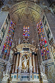 Old photo with interior at the Milan cathedral. One of the secondary altars, each devoted to a particular saint.