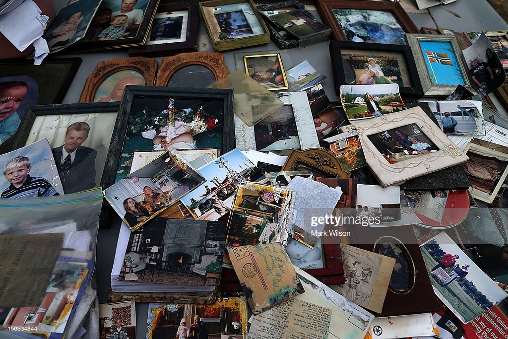 Old photographs are laid out on a car hood to dry after being removed from a home flooded by Superstorm Sandy on November 25, 2012 in Seaside Heights, New Jersey. New Jersey Gov. Christie estimated that Superstorm Sandy cost New Jersey $29.4 billion in damage and economic losses.