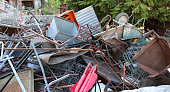many old rusty irons piled in a landfill