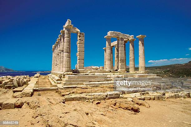 Old pillars of the Temple of Poseidon, Athens, Greece