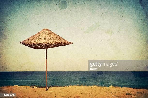 Old postcard, beach umbrella on shore
