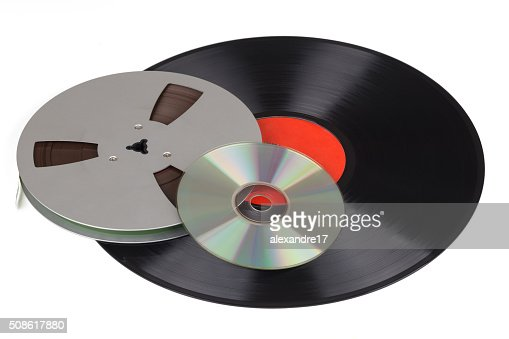 old record, tape reel with a music CD : Stock Photo