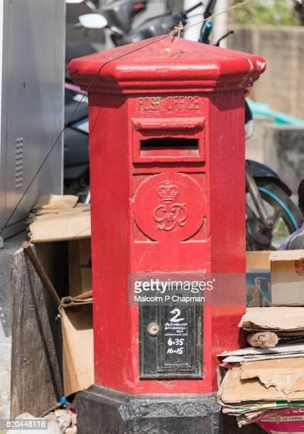 Old red British colonial post office pillar box (mailbox), Trincomalee, Sri Lanka