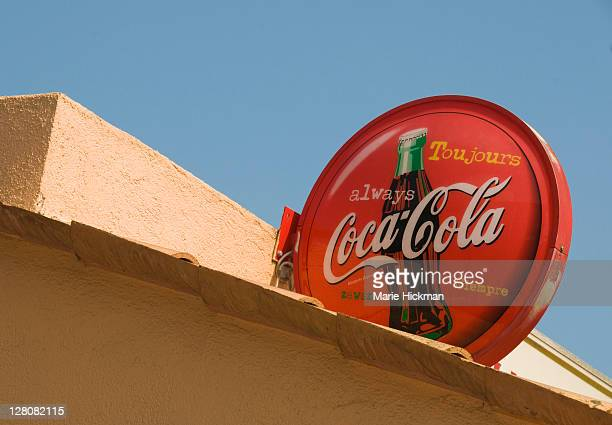 Old red Coca Cola sign on rooftop, Vallauris, South of France