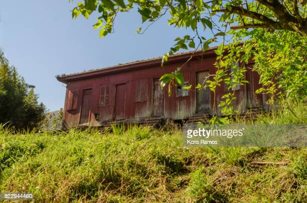 Old red wooden house with green lawn and blue sky in the interior of São Paulo in Brazil