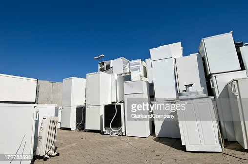 Old Refrigerators Waiting to Be  Scrapped At a Recycling Center