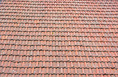 Roof tiles, Old retro rustic vintage red and orange roof tiles on the old house rooftop background