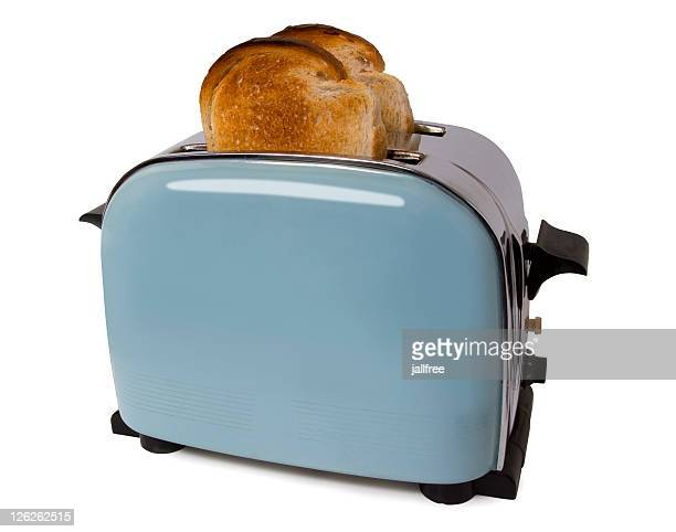 Old retro toaster with toast in on white with path