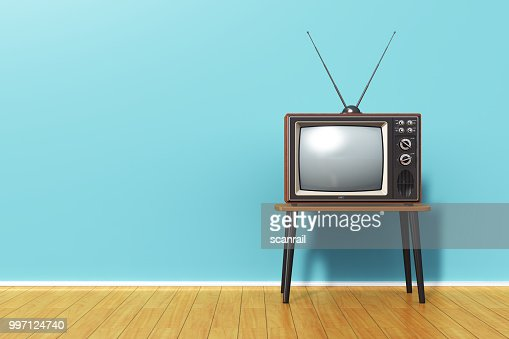Old retro TV against blue vintage wall in the room : Stock Photo