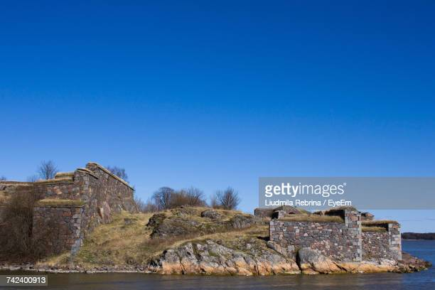 Old Ruin On Mountain Against Clear Blue Sky