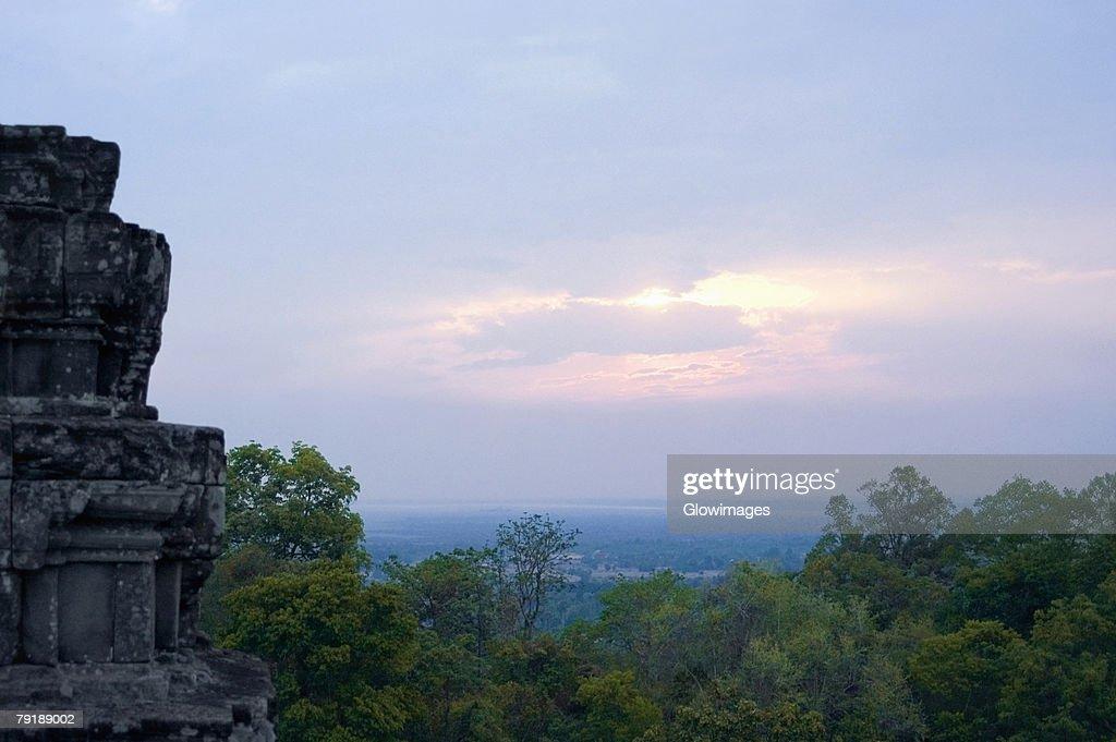 Old ruins of a temple at sunset, Phnom Bakeng, Angkor, Siem Reap, Cambodia : Stock Photo