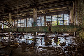 Old rusted submarine torpedoes in abandoned torpedo factory.