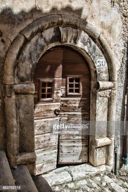 Old rustic scraped wooden door, Abruzzo, Italy