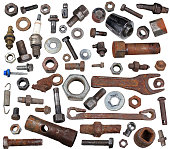 Old rusty bolts, nuts and mechanical parts isolated on white background