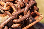 Old rusty chain. Rusted anchor chain. Material corrosion.