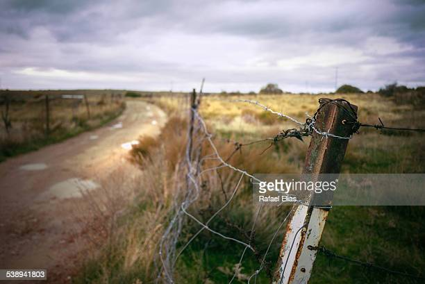 Old rusty fence and fencing wire