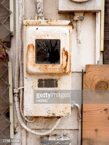 old rusty fuse box pealing paint on abandoned house stock old rusty fuse box pealing paint on abandoned house stock photo