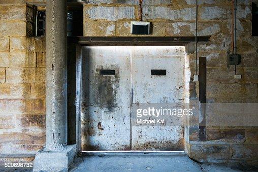 Rusty Metal Door old rusty metal door in sandstone building stock photo | getty images