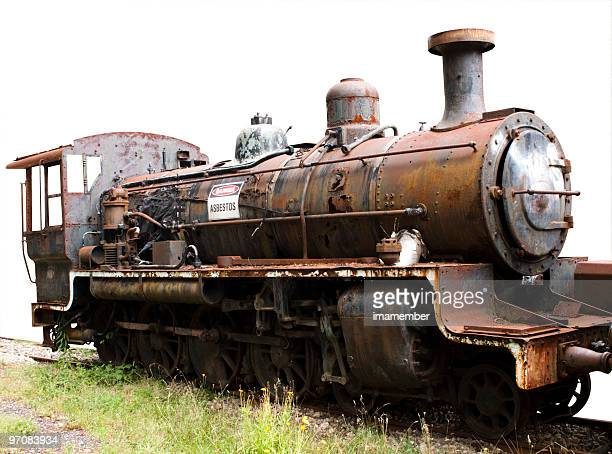 Old rusty steam locomotive with sign 'Danger asbestos' white background