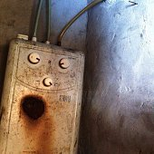 Old Rusty Water Heater On Wall