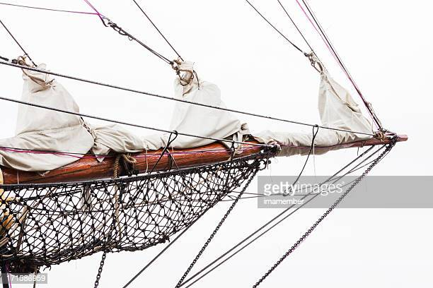 Old sailing ship bowsprit against white background, copy space