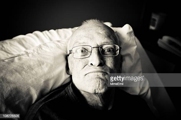 Old, Senior Man Lying in Hospital Bed