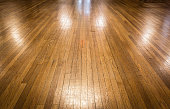 horizontal image of a bare vintage shiny and polished hardwood floor great for a background.