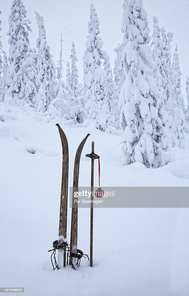 Old skis with ornament in snowy forest