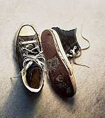 Old sneakers with holes in them
