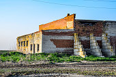 Old soviet brick abandoned building. Collapsing brick construction. white and red brick