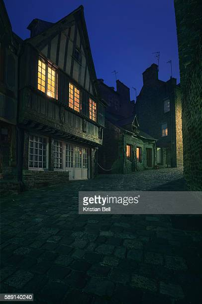 Old spooky street in French town at night