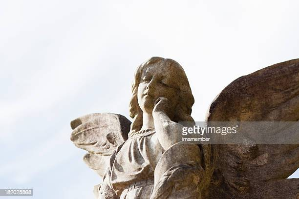 Old statue of angel against sky, copy space
